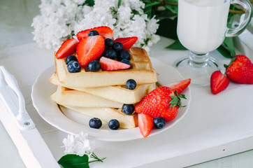 Homemade waffles with berries for breakfast