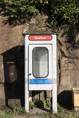 Old metal phone booth outdoors