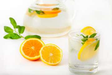 Cold lemonade with lemon slices and mint leaves
