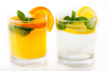 Lemon And Orange Juice with mint leaves and slices of fruit