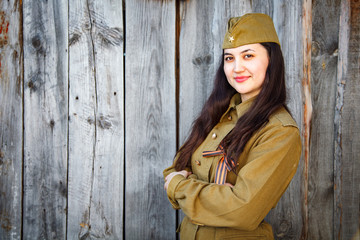 Beautiful young woman in a military uniform
