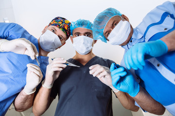 team of doctors with medical instruments in masks. bottom patient views