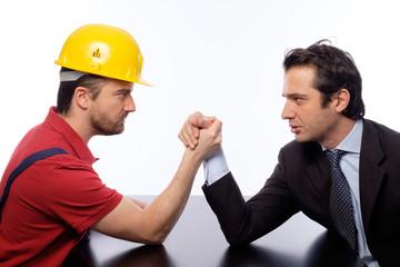 arm wrestling between business boss white collar versus worker