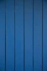 Dark blue wood panels used as background for designer