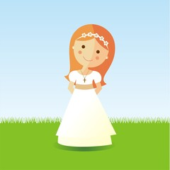 First Communion girl with red hair in a garden