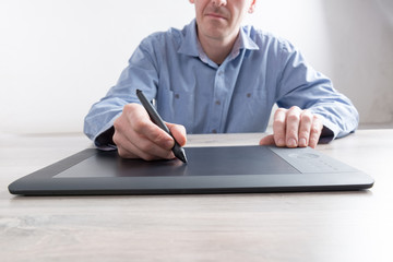 Man using graphical tablet
