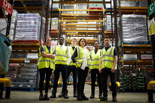 Group portrait of staff at distribution warehouse, low angle