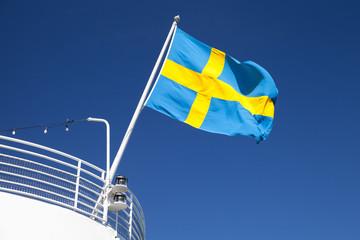 Swedish flag waving over blue sky