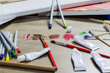 Working artist tools, mixing paints, creative.