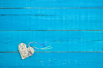 Wicker heart with lock and key and rainbow ribbon