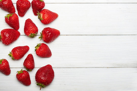 strawberry fruits on wooden background