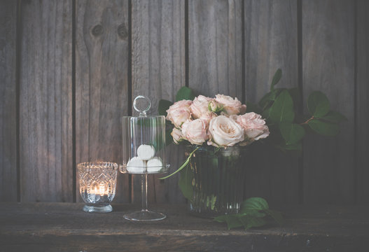 Elegant vintage wedding table decoration with roses and candles