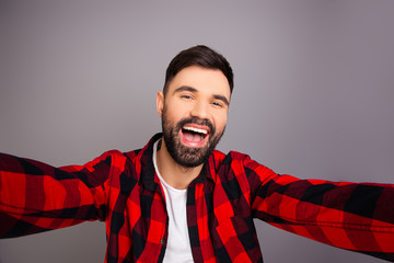 Comic cheerful happy young man making selfie