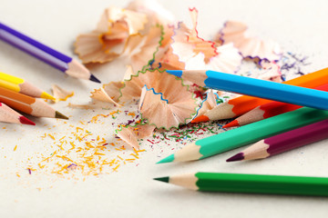 Drawing colourful pencils on a white background, close up