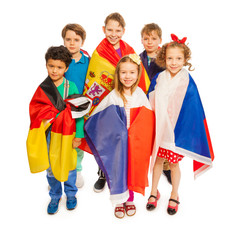 Top view of kids wrapped in European nations flags