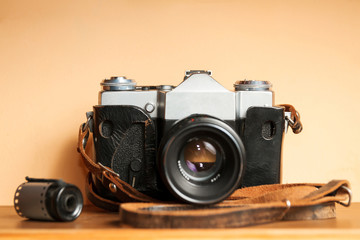 Vintage Camera with old photographs and films on a wooden table