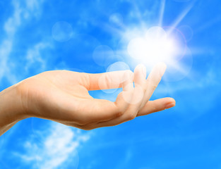Female hand with sun