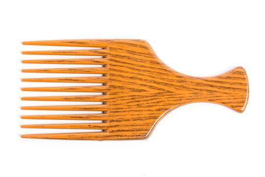Orange afro pick on white background