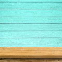 Vintage wood table in blue wood wall room.