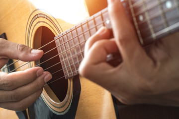 Play music with a guitar