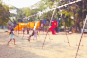 Defocused and blur image of children's playground at public park