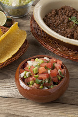 salsa, taco shells and ground beef