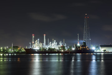 Beautiful light of oil refinery factory in night time.