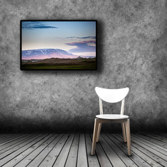 Plasma TV on the wall of the room with empty chair