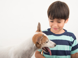 Little boy playing with his friend dog jack russel