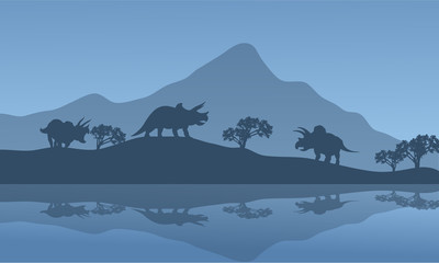Silhouette of triceratops in the riverbank