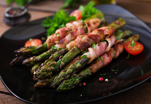 Grilled violet asparagus wrapped with bacon