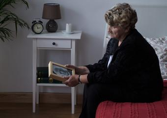 Elderly widowed lady in grief