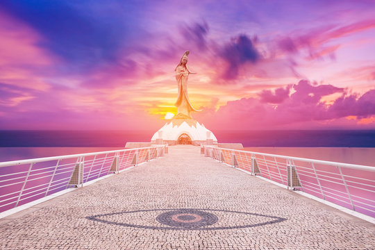 Statue of kun iam macau in sunset background