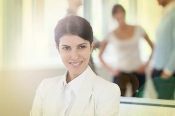 Portrait of attractive businesswoman standing in business room
