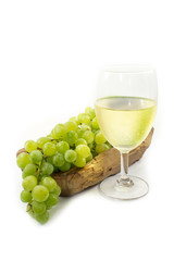 Green Grapes on Wood Plate with White Wine Glass Isolated, white background