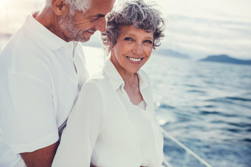 Happy mature couple on yacht