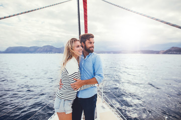 Young couple relaxing on yacht