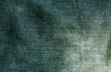 Green jeans cloth texture.