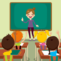 Beautiful happy young teacher woman standing teaching in front children raising hands up sitting in classroom