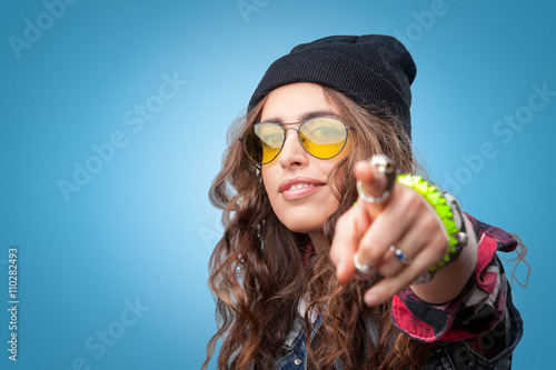 f7fbae88f04 Closeup portrait of beautiful trendy hipster girl with long curly hair  pointing finger at you and smiling wearing checkered shirt