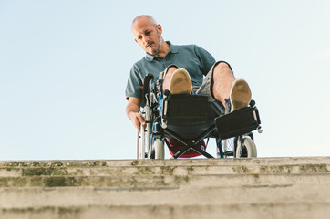 Man with disease on a wheelchair