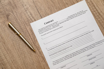contract papers with pen on desk
