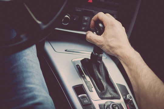 Hand on gear stick