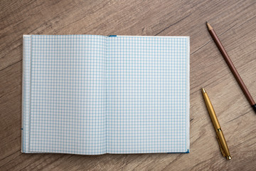 empty notepad with pen on desk