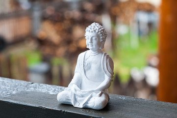 Image of sitting Buddha on blurred background. Meditation concept