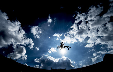 Motorcyclist performing a high jump