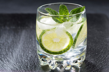 carbonated lemonade with ice in a glass