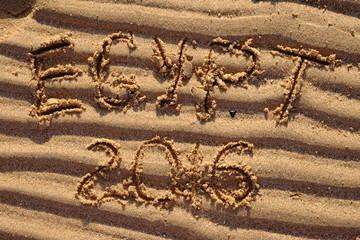 Egypt 2016 words written on raw sand  at beach