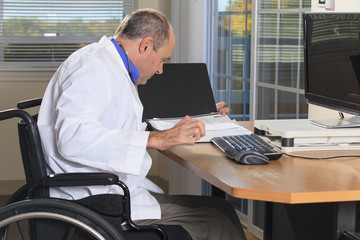 Man with deformed hands working as doctor