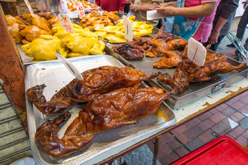 Whole roasted duck on trays at Chinese market